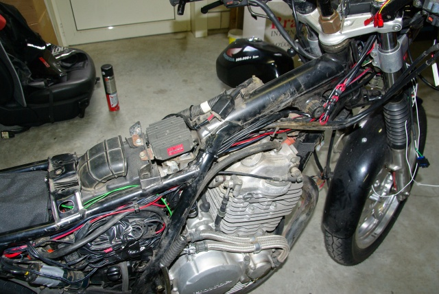 Wiring between the distributino box (left, in the black dry bag) and the cockpit.