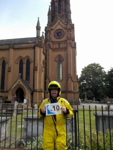 2:22 p.m. St. Margaret Church insouth east London. 27°C, sunny. A man in a yellow rain suit. Don't worry, he's mostly harmless.