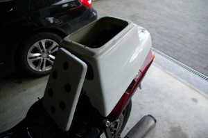 A police seat pod to cover a future auxiliary tank