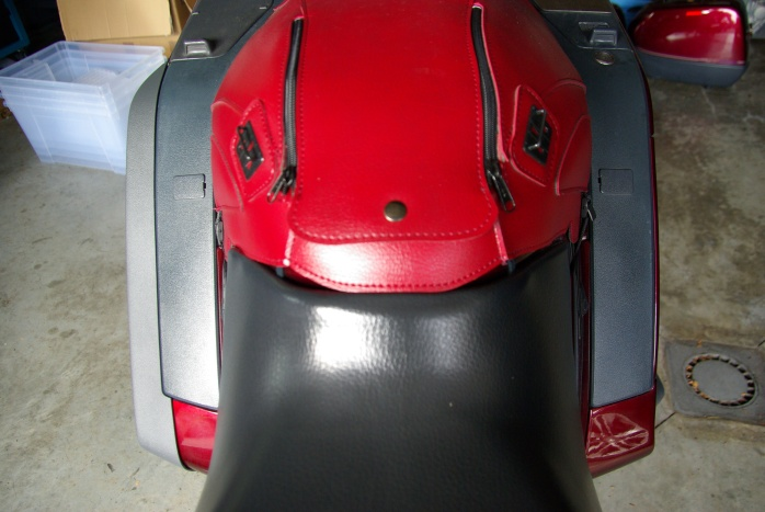 The original Honda fairing deflector installed (left) and not yet installed (right).